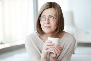 Portrait Of Calm Mature Woman With Cup