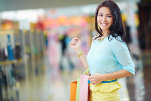 Portrait Of Young Woman With Colorful Shopping Bags