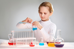 Lovely Girl Spending Her Free Time In A School Laboratory Working With Chemicals