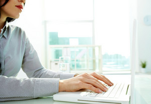 Business Lady Typing On Laptop At Office