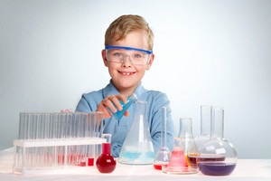 An Enthusiastic Boy Looking At Camera During Experiment