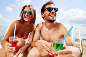 Relaxed Young Lovers With Drinks Having Beach Party