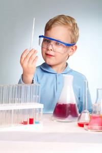 Boy In Protective Eyeglasses Being Curious About Lab Equipment