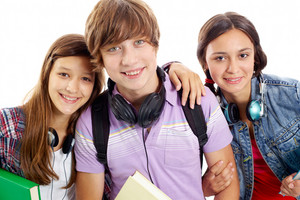 Cute Teens With Headphones Smiling At Camera