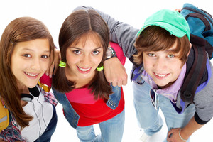 Three Teenagers In Casual Clothes Posing In Front Of Camera