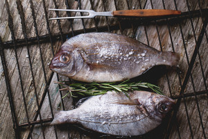 Tow Raw Fish With Rosemary On Grill