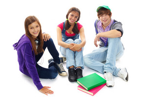 Three Teenagers In Casual Clothes Sitting In Isolation