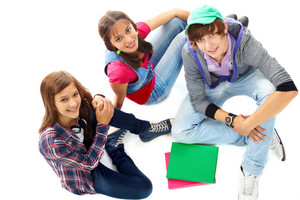 Three Teenagers In Casual Clothes Looking At Camera
