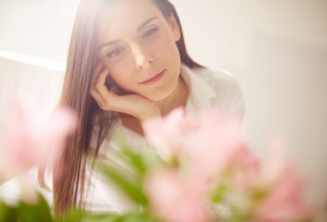 Portrait Of Lovely Lady Looking At Flowers