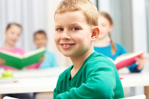 Cute Lad Looking At Camera On Background Of His Classmates
