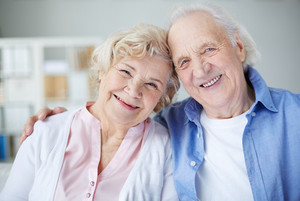 Portrait Of Cheerful Seniors Looking At Camera With Smiles
