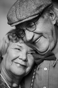 Black-and-white Image Of Senior Couple In Smart Clothes