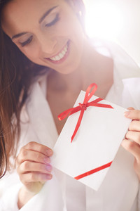 Image Of Smiling Female Holding Valentine Letter