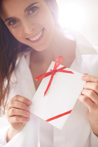 Image Of Smiling Female Holding Valentine Letter And Looking At Camera