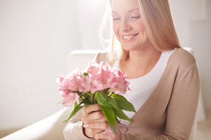Image Of Smiling Female Holding Bunch Of Pink Lilies
