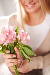 Close-up Of Smiling Female Holding Bunch Of Pink Lilies