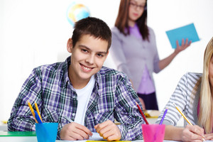 Portrait Of Happy Lad Looking At Camera During Lesson