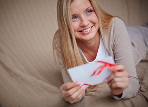 Image Of Young Smiling Female With Valentine Letter