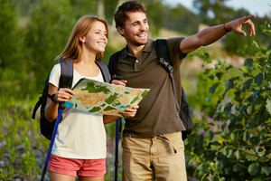 Portrait Of Couple Of Hikers In The Countryside At Summer
