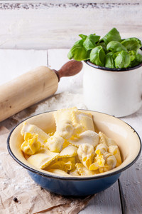 Pasta Ravioli With Flour And Basil