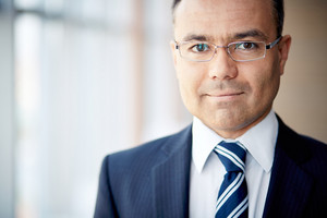 Portrait Of Confident Businessman In Eyeglasses Looking At Camera