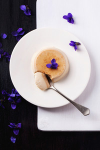 Caramel Pannacotta With Violet Flowers