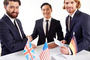 Image Of Three Partners Making A Deal After Negotiations With American