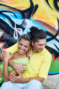 Image Of Young Guy Embracing His Girlfriend On Background Of Graffiti Wall