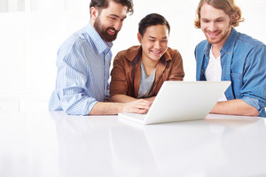 Smiling Men In Casual Using Laptop