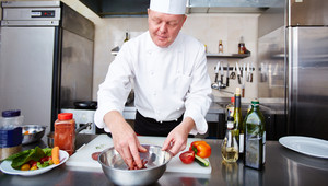 Image Of Male Chef Cooking Meat In The Kitchen