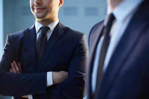 Cropped Image Of A Confident Businessman Standing Near His Colleague On The Foreground