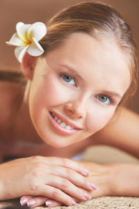 Face Of Young Female Ready For Massage Looking At Camera