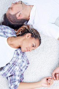 Image Of Serene Guy And Girl Lying On The Floor And Having Rest