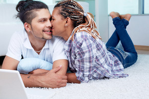 Image Of Young Guy And His Girlfriend Having Rest At Home