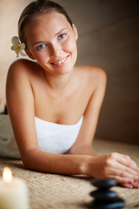 Portrait Of Young Female Looking At Camera In Spa Salon