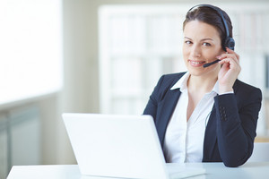 Young Customer Support Representative Looking At Camera With Smile