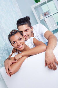 Image Of Young Guy And His Girlfriend Looking At Camera While Relaxing At Home