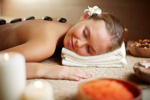 Portrait Of Young Female Enjoying Spa Procedure In Beauty Salon