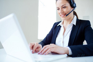 Young Customer Support Representative Networking In Office