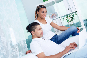 Image Of Young Guy And His Girlfriend Using Laptop At Home