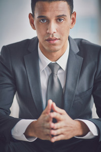 Calm Businessman In Suit Looking At Camera