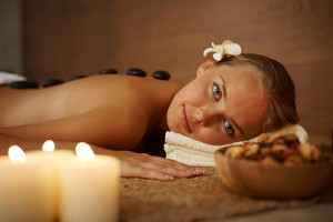 Portrait Of Young Female Looking At Camera During Spa Procedure In Beauty Salon