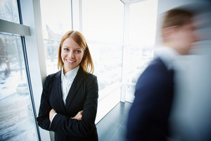 Image Of Successful Businesswoman Looking At Camera On Background Of Window