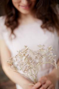 Dry Flowers Held By Woman