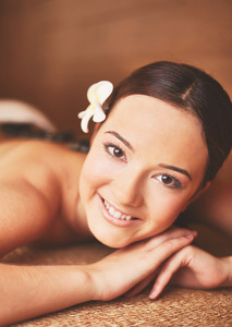 Portrait Of Young Female Ready For Massage Looking At Camera In Spa Salon