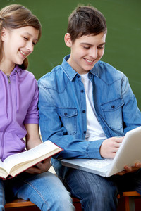 Portrait Of Guy And Girl Being Busy During Lesson