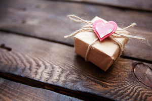 Image Of Valentine Giftbox With Small Pink Heart On Wooden Background