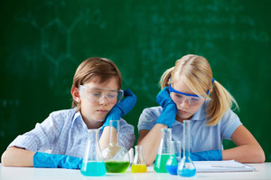 Two Children Looking At Tubes With Chemical Liquids