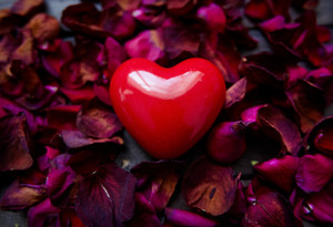 Image Of Big Red Heart Surrounded By Rose Petals
