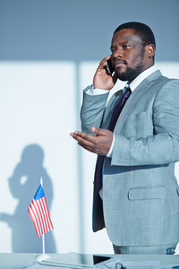 Serious Boss Talking To Employee On The Phone